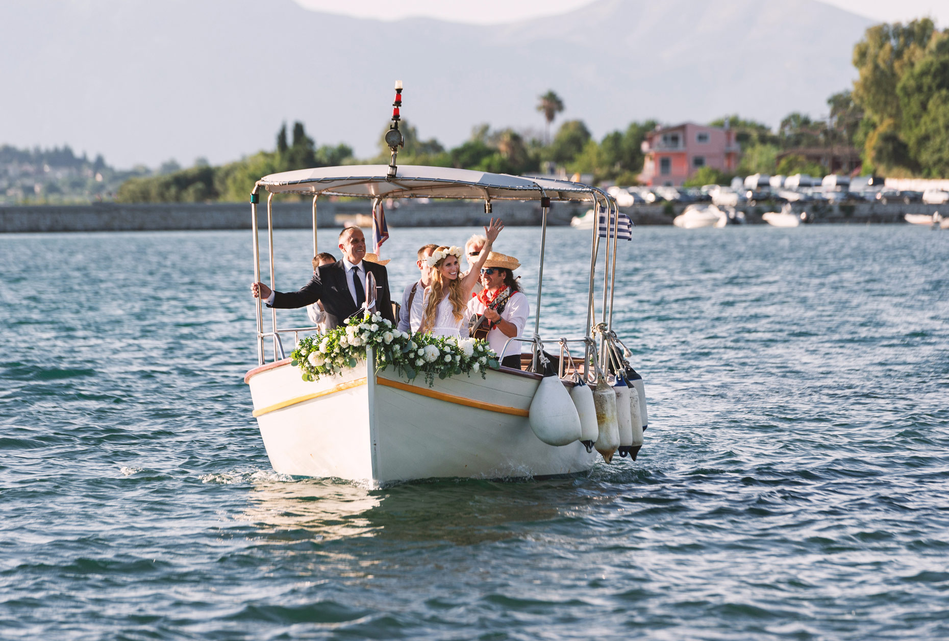 bride goes to church with boat | corfu wedding